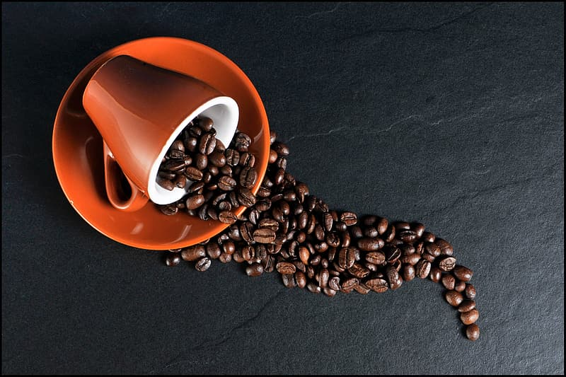 Coffee beans and teacup with plate