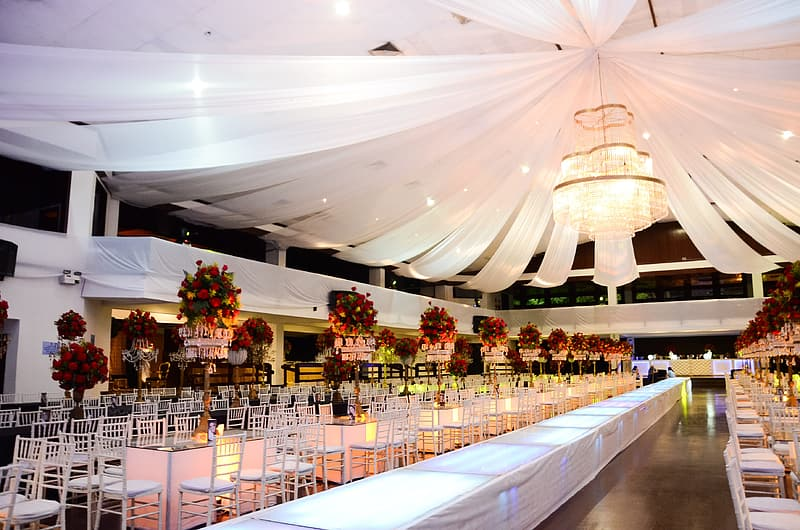 White tables and chairs in room with white decors