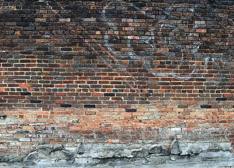 Brown brick wall with gray and white stone wall