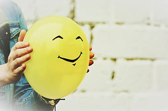 Yellow balloon with face print