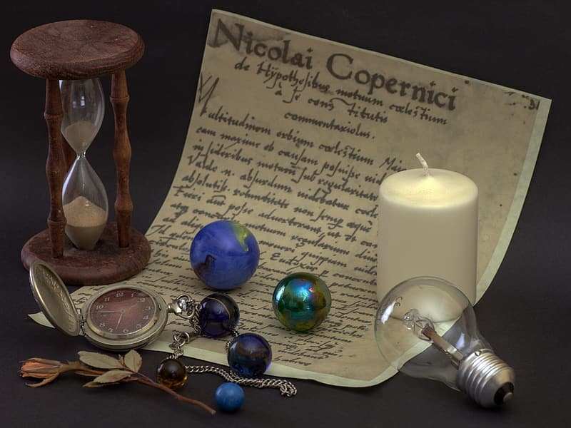 Pocket watch, marbles, and white candle