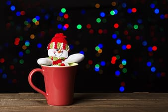 White snow man in red cup