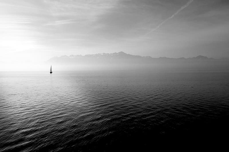 Boat sailing on the body of water