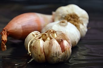 Garlic on black table top