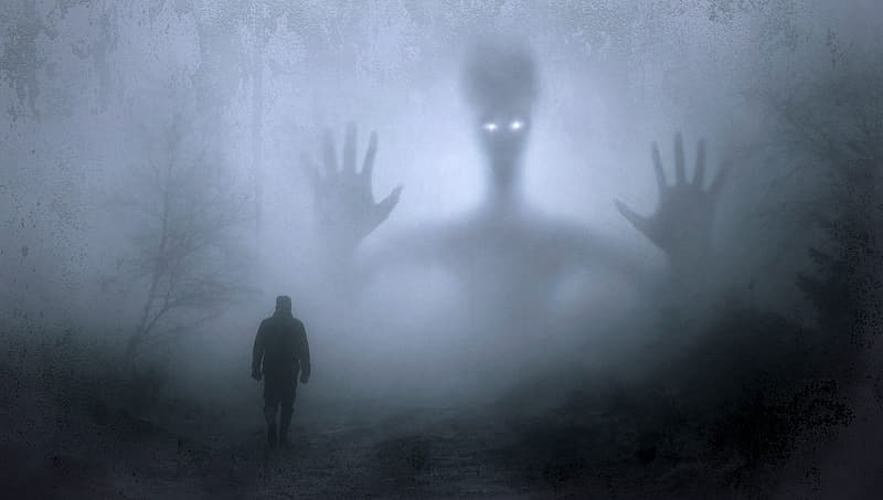 Silhouette of a person with ghost and mist