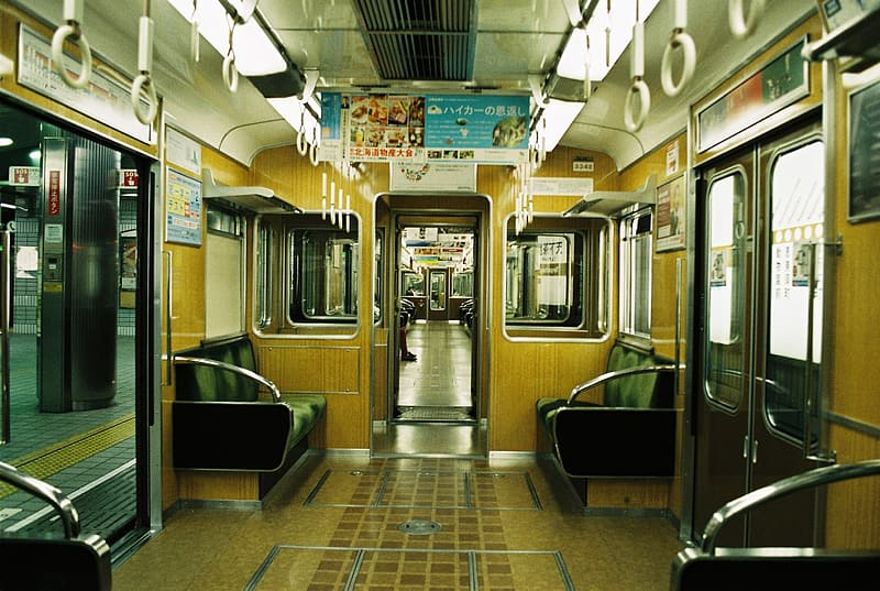 People sitting inside train during daytime
