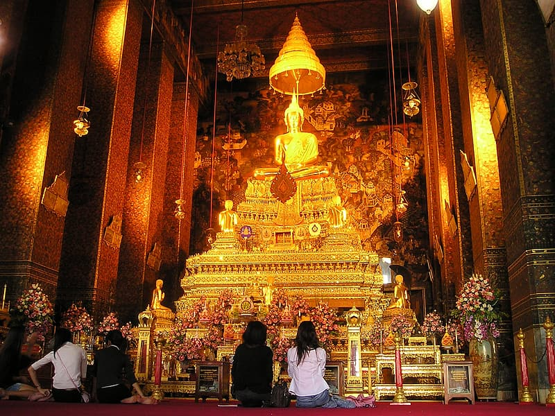 Four people in front of Buddha altar