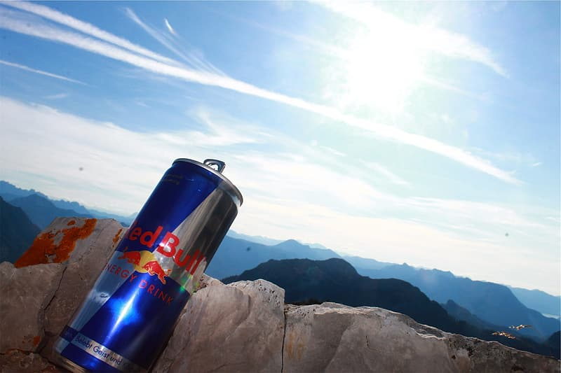 Red Bull energy drink can on concrete slab during daytime