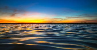 Photo of body of water during golden hour