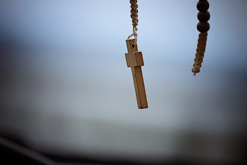 Shallow focus photography of brown wooden cross accessory
