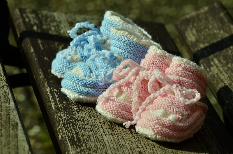 Toddler's two pairs of teal and pink bootees