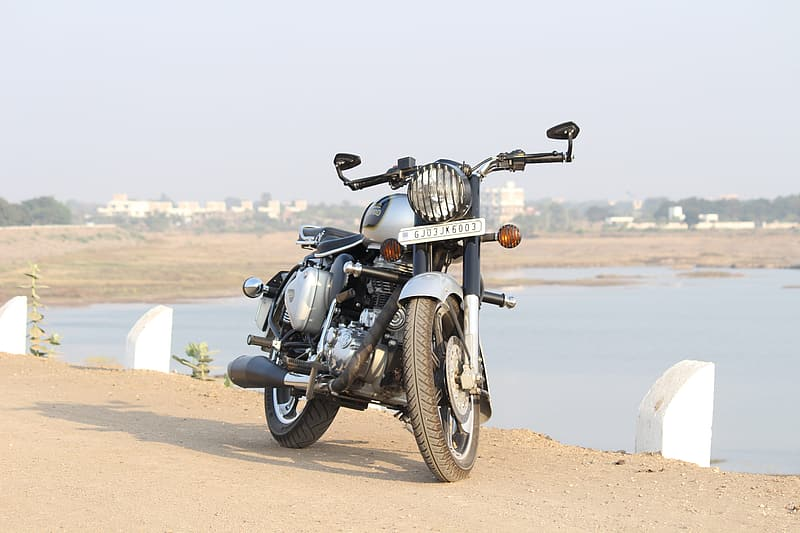 Black and gray cafe racer near body of water
