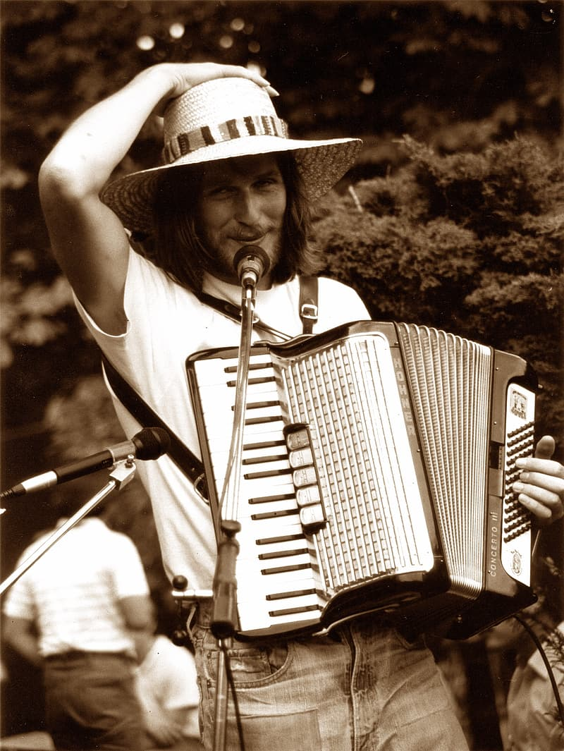Photography of man playing accordion