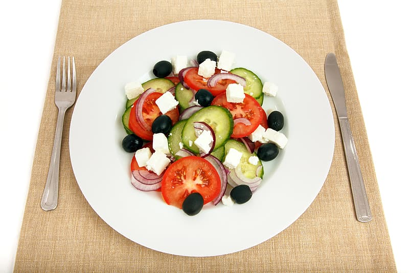 White ceramic plate with slices of vegetables