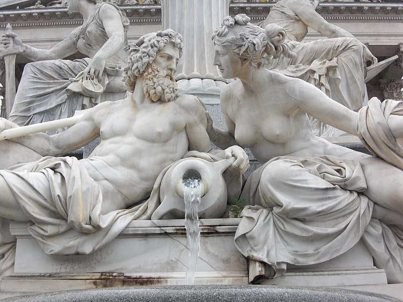 Man and woman holding vase statue