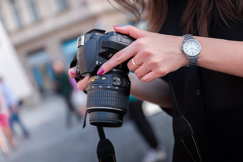 Person's holding camera