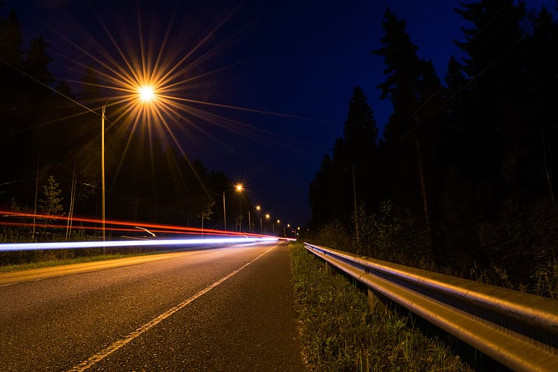 Time-lapse photo of highway during nighttime