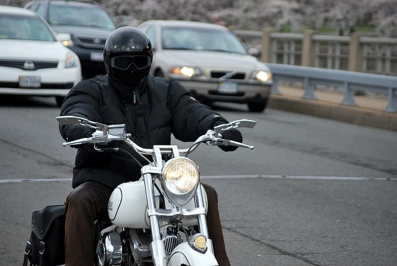 Man riding on cruiser motorcycle on the street
