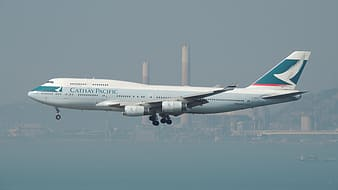 White and blue Cathay Pacific airplane