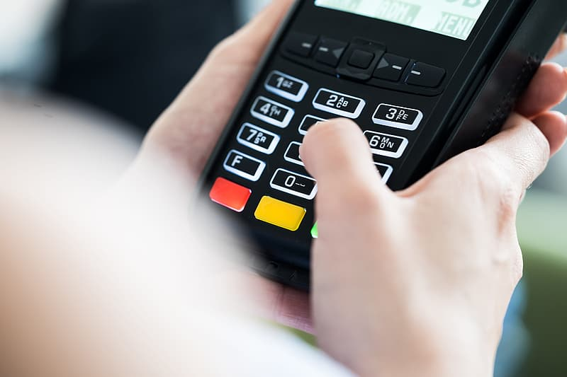 Shop Owner Accepting Credit Card Payment