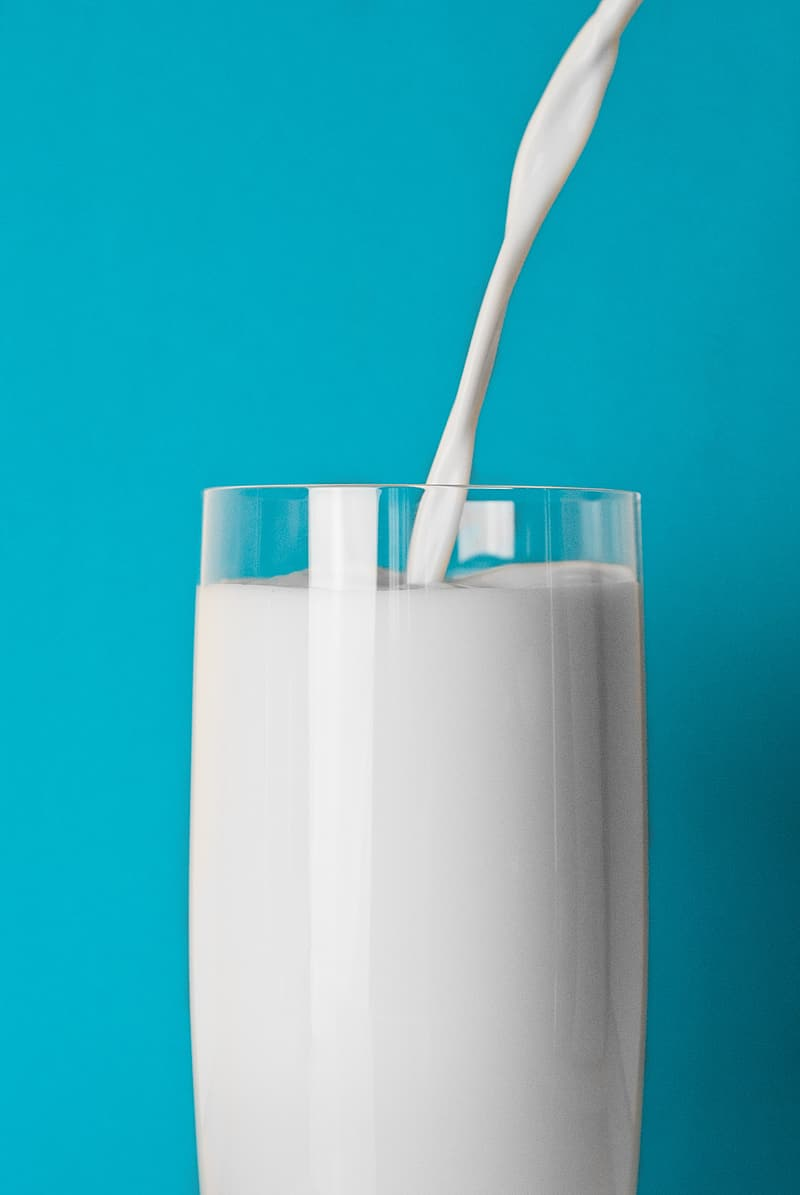 Clear pint glass filled with milk