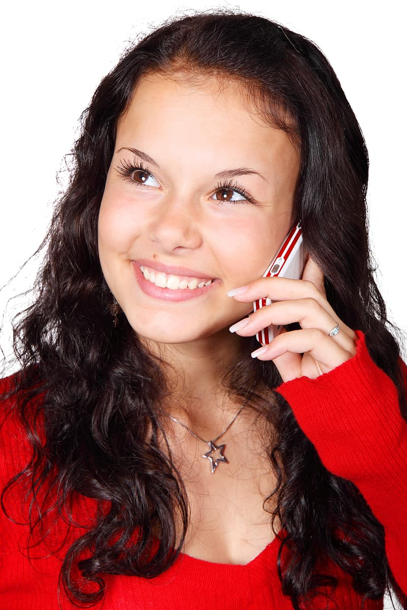 Woman holding white Android smartphone