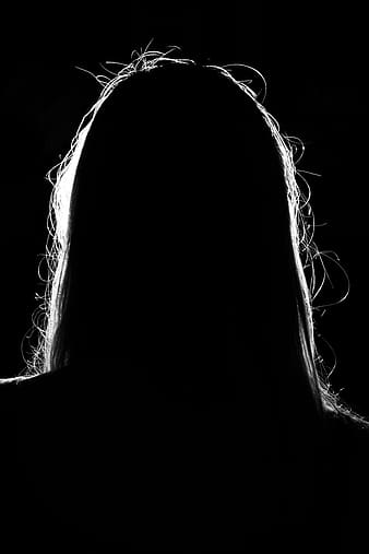 Silhouette photo of long-haired person