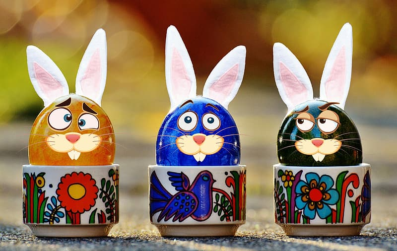 Three assorted-color rabbit ceramic figurines