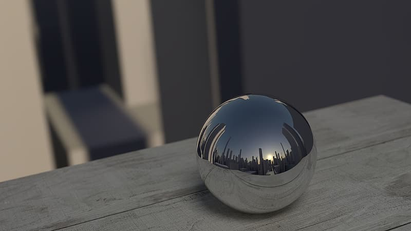 Silver ball decor on top of gray wooden surface