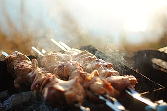 Closed up photo of skewered meat on grill