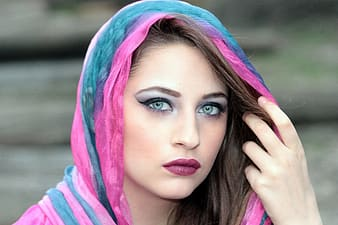 Woman wears blue and pink head scarf