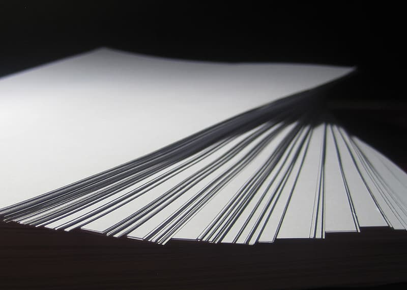 Selective focus photography of fan paper