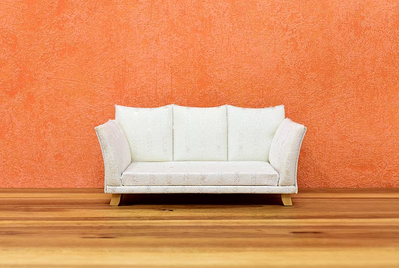 White sofa chair on brown wooden floor