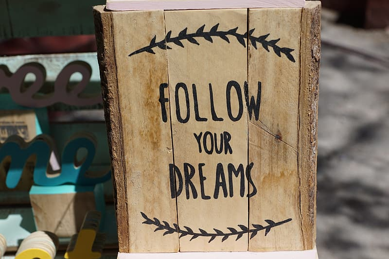 Rectangular brown and black Follow your dreams print wooden board