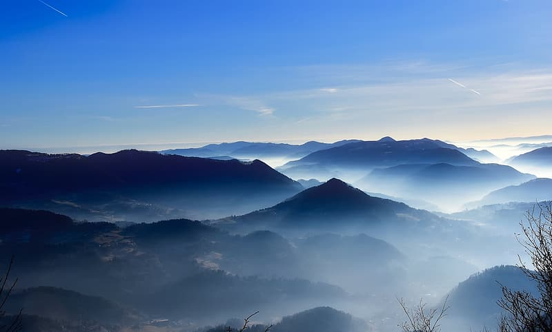 Mountains with fogs at daytime