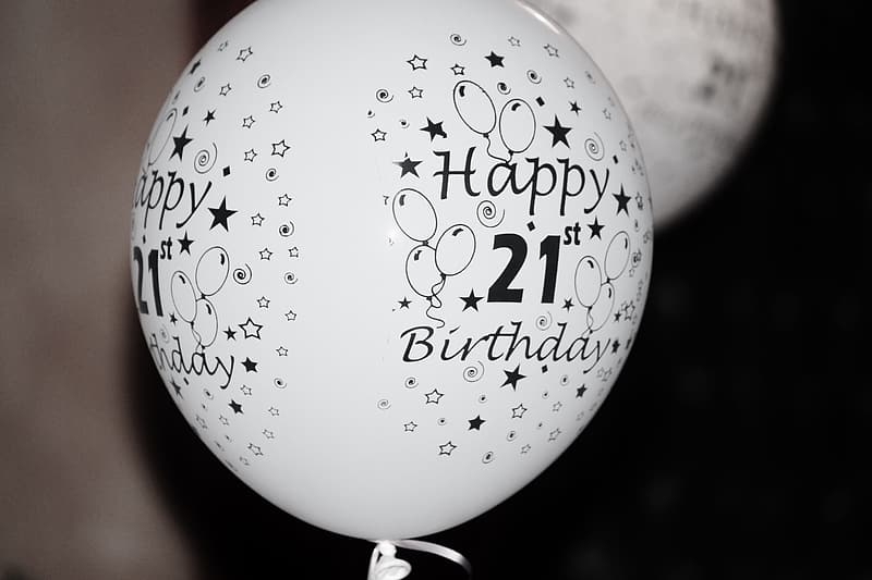 White and black happy 21st birthday printed balloon close-up photography
